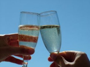 Two champagne glasses clinking